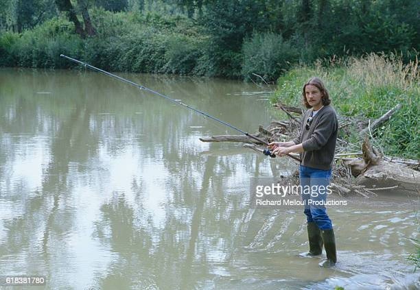 French Singer Francis Cabrel Fishing in a Lake