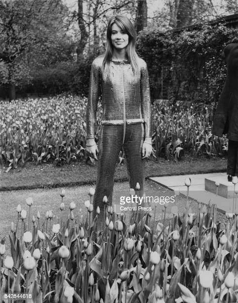 French singer Françoise Hardy wearing a metal trouser suit in a park near the Savoy Hotel, London, 23rd April 1968. She is appearing in cabaret at...