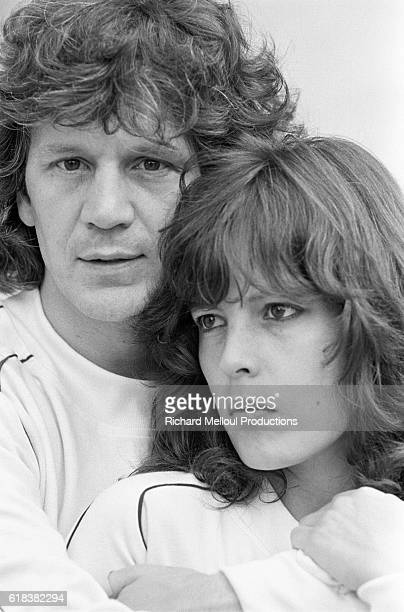 French singer Gerard Lenorman puts his arms around his wife Clemence
