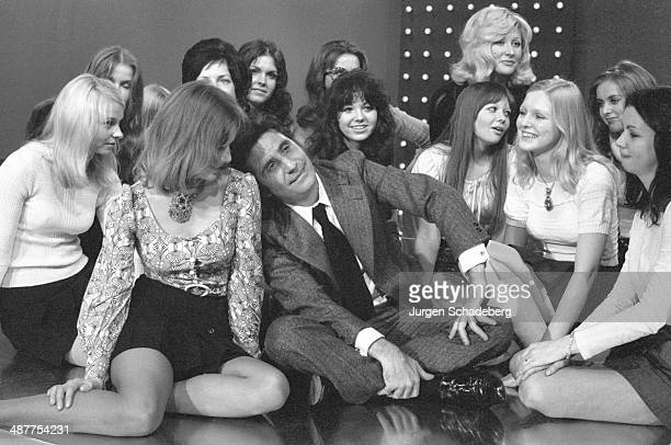 French singer Gilbert Bécaud surrounded by female fans during a visit to West Berlin Germany 1971