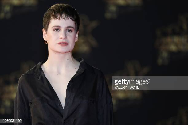 French singer Heloise Letissier aka Christine and the Queens or Chris poses on the red carpet upon her arrival to attend the 20th NRJ Music Awards...