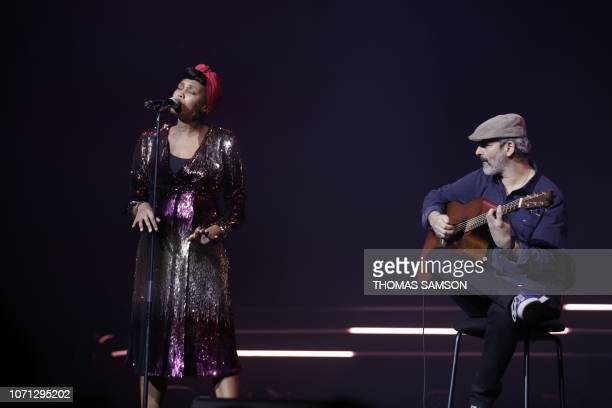 French singer Imany awarded best 'export Sacem repertoire' sings on stage during the SACEM Grand Prix awards ceremony on December 10 2018 at the...