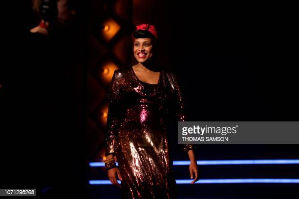 French singer Imany awarded best 'export Sacem repertoire' smiles on stage during the SACEM Grand Prix awards ceremony on December 10 2018 at the...