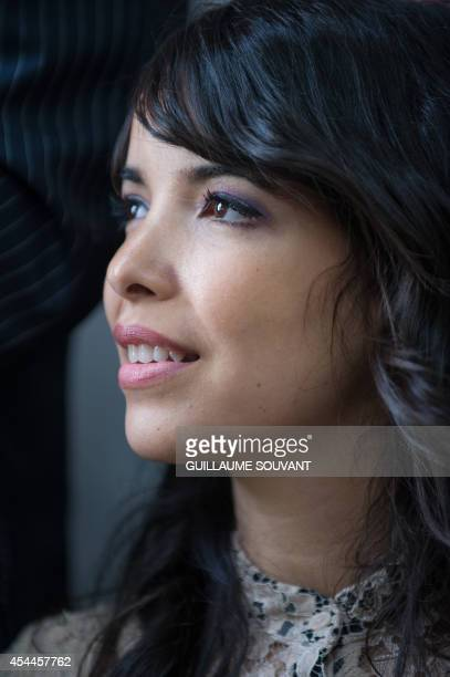 French singer Indila attends the 19th book fair 'La Foret Des Livres' on August 31 2014 in ChanceauxpresLoches central France AFP PHOTO / GUILLAUME...