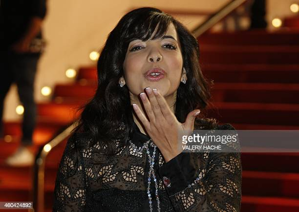 French singer Indila poses upon her arrival at the Palais des Festivals to attend the 16th Annual NRJ Music Awards on December 13 2014 in Cannes...