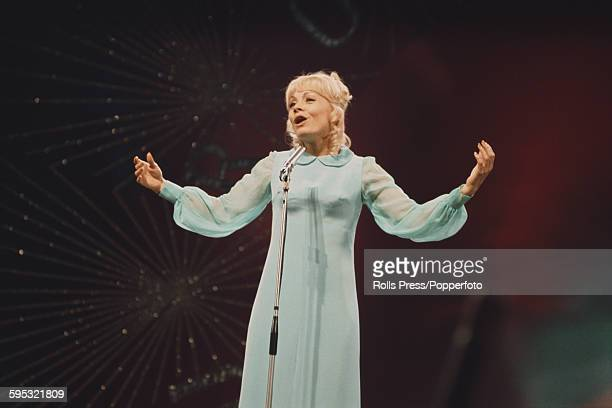 French singer Isabelle Aubret performs the song 'La source' on stage for France in the Eurovision Song Contest at the Royal Albert Hall in London on...
