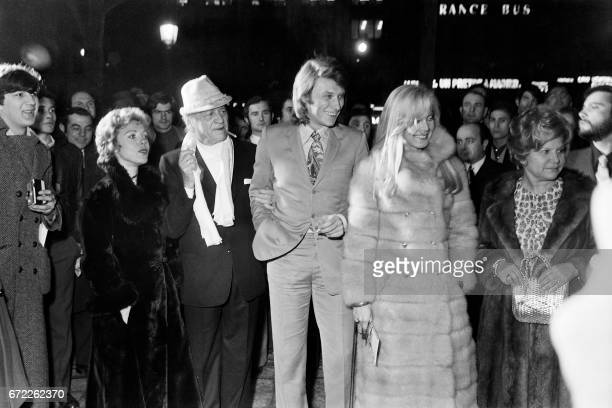 French singer Jacques Higelin French writer Henri Charriere french singer Johnny Hallyday and his wife Sylvie Vartan arrive for the premiere of the...