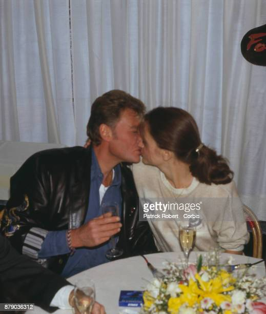 French singer Johnny Hallyday and his girlfriend Gisele Galante at the Fouquet's celebrating the promotion of the singer new leather jacket...