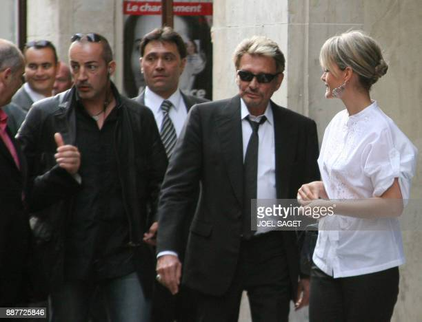 French singer Johnny Hallyday and his wife Laeticia arrive at the Union for a Popular Movement party headquarters 06 May 2007 in Paris French voters...