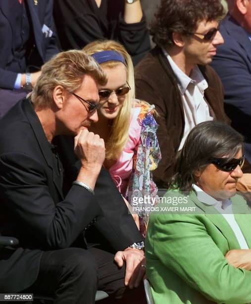 French singer Johnny Hallyday and his wife Laeticia French singer Patrick Bruel legendary Romanian tennis player Illie Nastase and president of the...