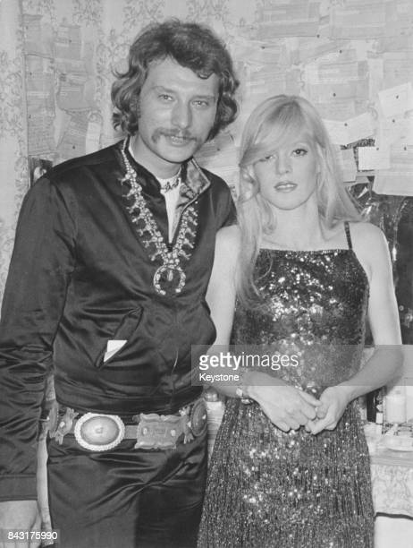 French singer Johnny Hallyday comes to congratulate his wife singer and actress Sylvie Vartan after her performance at the Olympia music hall in...