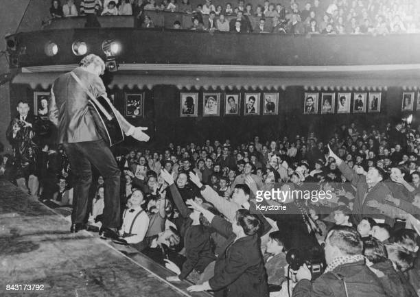 French singer Johnny Hallyday performs for an audience of under-16-year-olds at the Musicorama in Paris, France, 13th December 1962.