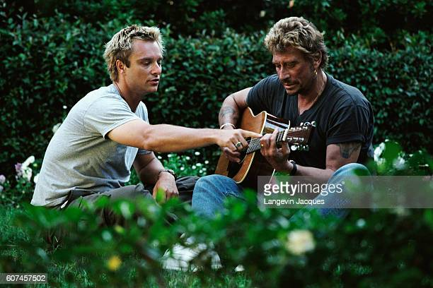 French singer Johnny Hallyday prepares his concert 'Allume le feu' in September at Stade de France near Paris Here with his son singer and songwriter...