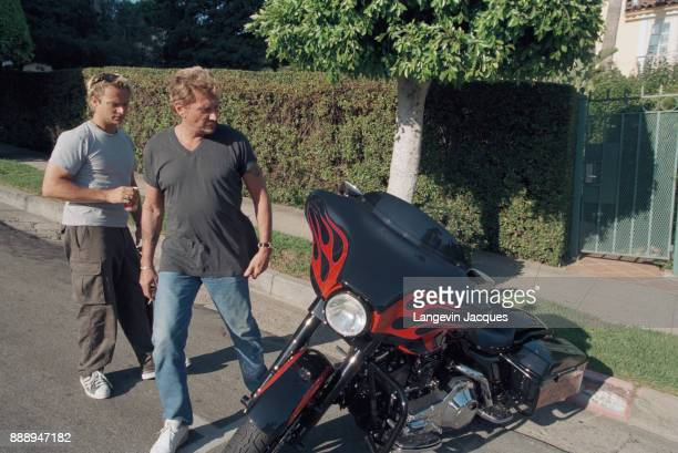 French singer Johnny Hallyday prepares his concert 'Allume le feu' in September at Stade de France, near Paris. Here, with his son, singer and...