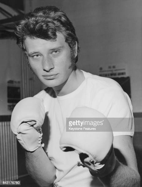 French singer Johnny Hallyday wearing boxing gloves, June 1967.