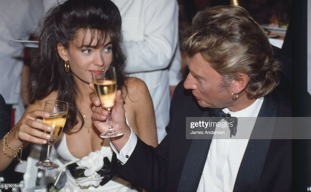 French singer Johnny Hallyday with his wife Adeline at opening dinner of 47th Cannes film festival, 10th May 1990