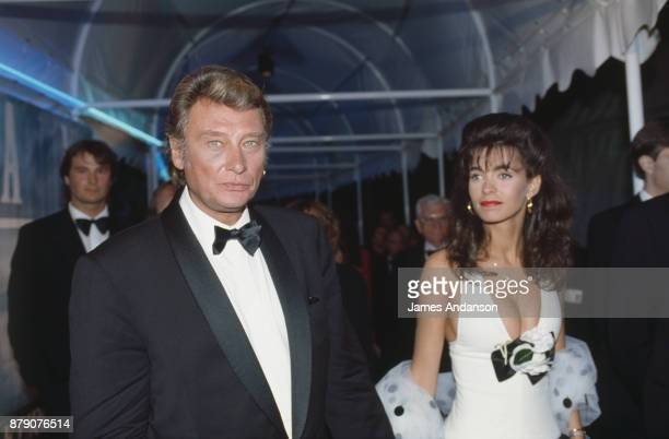 French singer Johnny Hallyday with his wife Adeline at opening dinner of 47th Cannes film festival 10th May 1990
