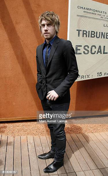 French singer Julien Dore arrives at the 'Village' the VIP area of the French Open at Roland Garros arena May 30 2008 in Paris France