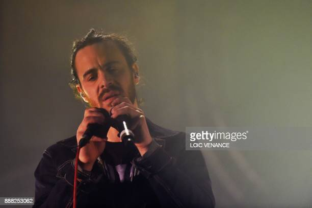 French singer Krismenn performs on December 7 2017 in SaintJacquesdelaLande outside Rennes as part of the 39th edition of the Trans Musicales music...