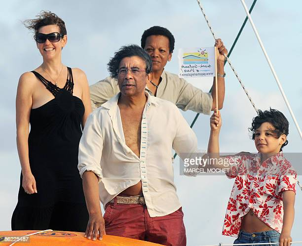 French singer Laurent Voulzy , his son Quentin , his wife Mirella and the widow of French skipper Eric Tabarly, Jacqueline welcome French skipper...