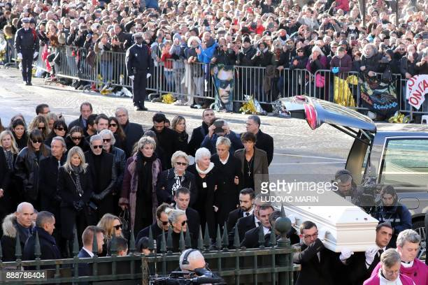 French singer Line Renaud and French comedian Muriel Robin arrive outside the La Madeleine Church at the start of the funeral ceremony in tribute to...