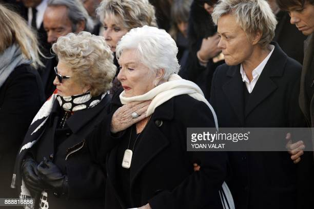 French singer Line Renaud and French comedian Muriel Robin arrive to attend the funeral ceremony for late French singer Johnny Hallyday outside the...