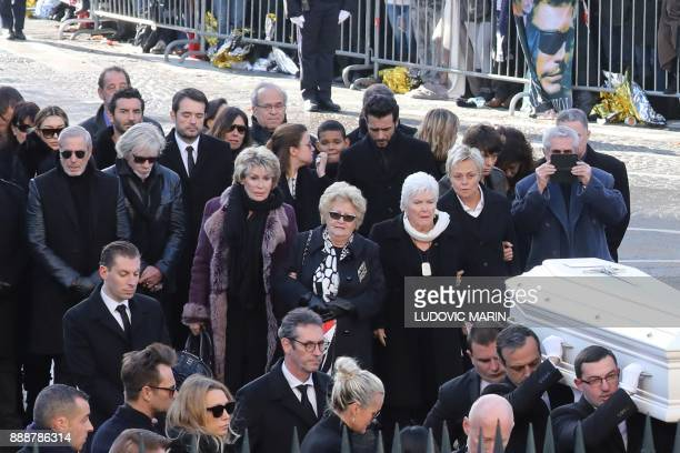 French singer Line Renaud French comedian Muriel Robin and French film director Claude Lelouch arrive outside the La Madeleine Church at the start of...