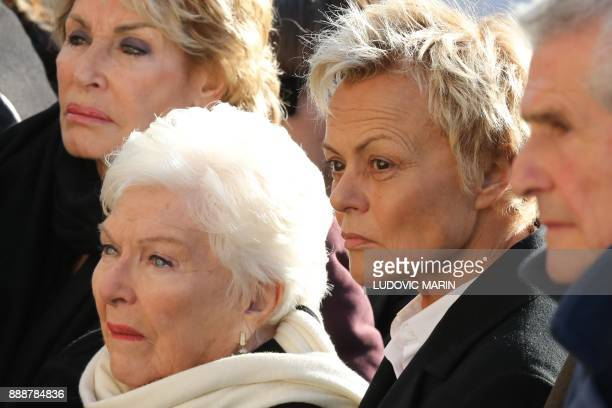 French singer Line Renaud French humorist Muriel Robin and French film director Claude Lelouch stand outside the La Madeleine Church prior to the...