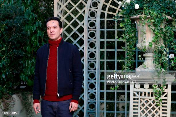 French singer Malik Djoudi poses for a photocall prior to the Chanel's fashion show during the 2018 spring/summer Haute Couture collection on January...