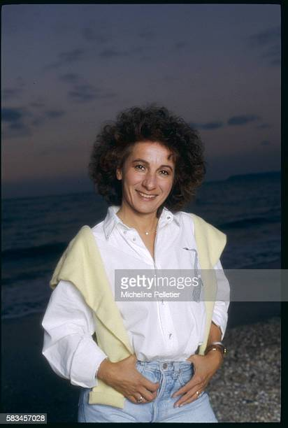 French singer Marie Paule Belle enjoys an eveing stroll on the beach of Deauville