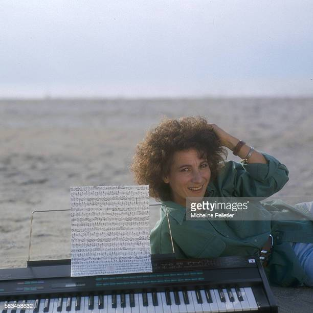 French singer Marie Paule Belle poses with her keyboard on the beach of Deauville