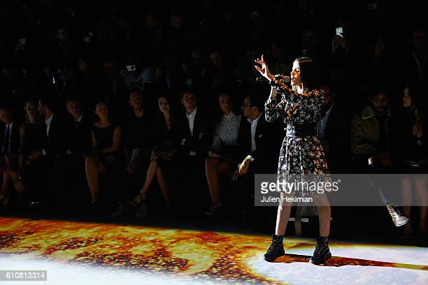 French Singer Marina Kaye performs on the catwalk during the Etam show as part of the Paris Fashion Week Womenswear Spring/Summer 2017 on September...
