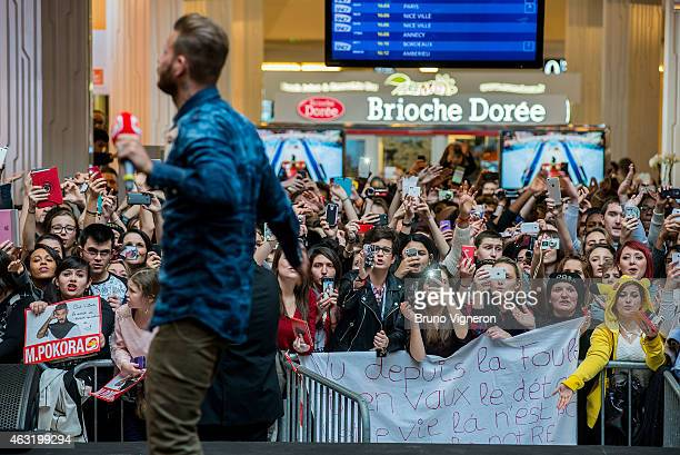 French singer Matt Pokora performs in front of a crowd of fans during a public showcase organized by Radio Scoop at PartDieu shopping center on...