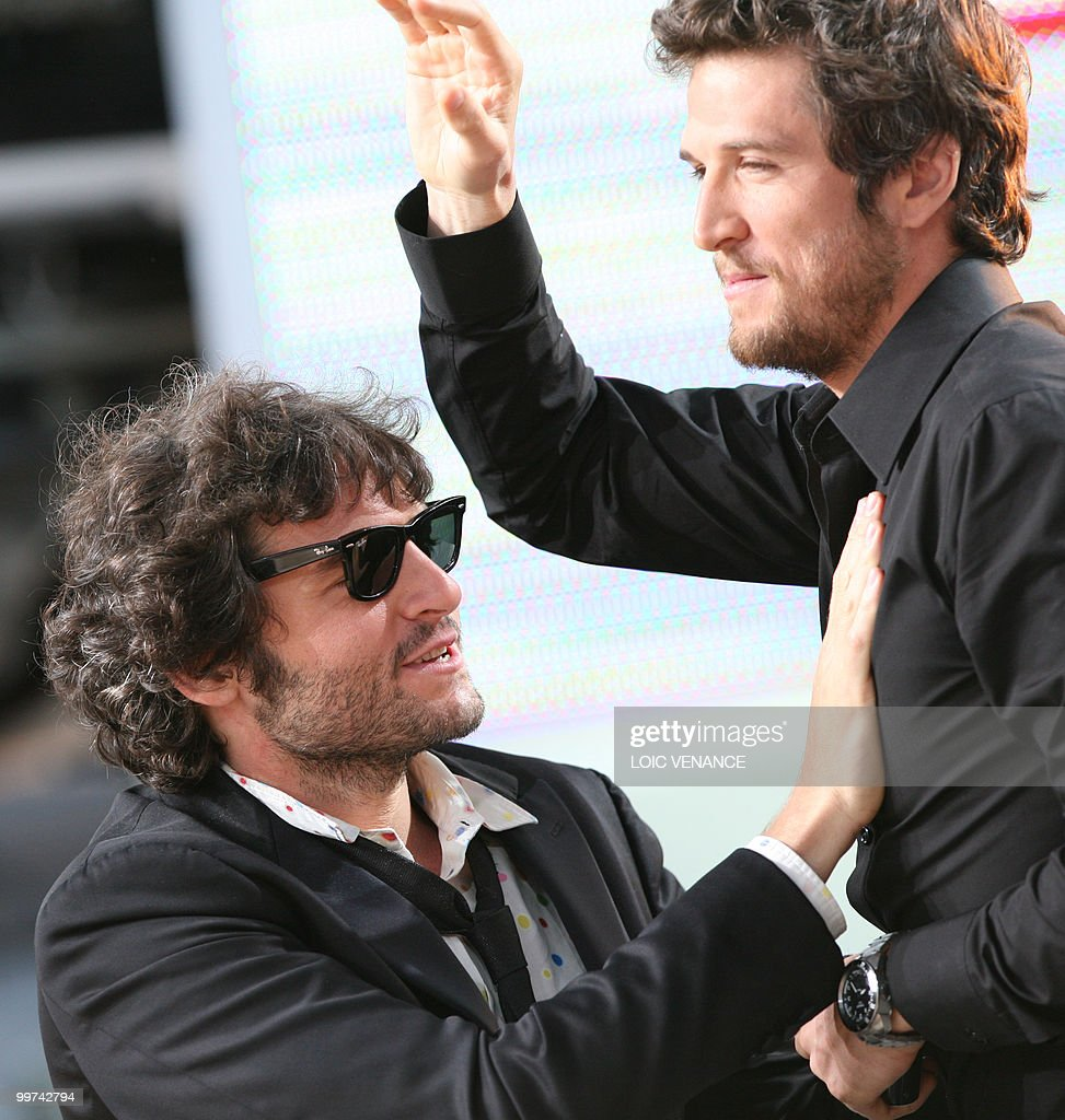 French singer Matthieu Chedid also known as 'M' and French actor Guillaume Canet (R) attend the Canal+ TV show 'Le Grand Journal' at the 63rd Cannes Film Festival on May 17, 2010 in Cannes.
