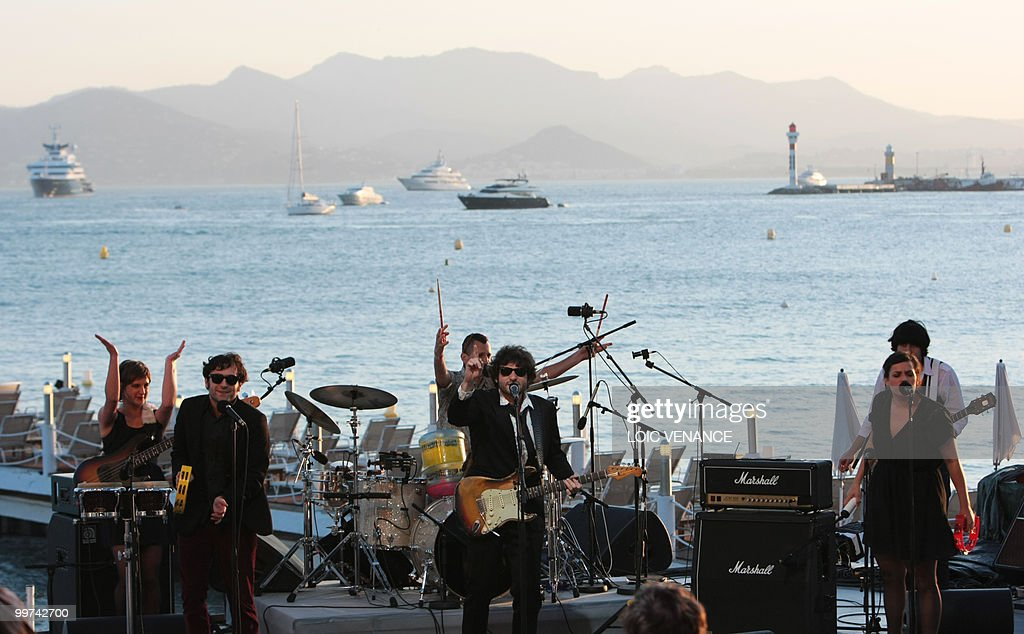 French singer Matthieu Chedid (C) also known as 'M' performs during the Canal+ TV show 'Le Grand Journal' at the 63rd Cannes Film Festival on May 17, 2010 in Cannes.