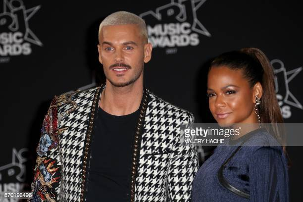 French singer Matthieu Tota aka M Pokora and his partner Christina Milian pose upon their arrival to attend the 19th NRJ Music Awards at the Palais...