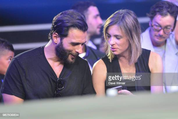 French singer Maxime Nucci and his partner French journalist and tv presenter Isabelle Ithurburu during La Conquete Acte 5 boxing event on June 23...