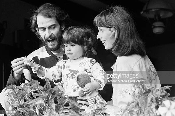 French singer Michel Fugain and his wife play with their young daughter at home in Grenoble A successful musician Fugain returned to his hometown of...