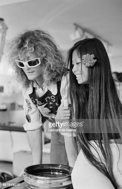 French singer Michel Polnareff and his girlsfriend ShuFi a ChinoTahitian flight attendant