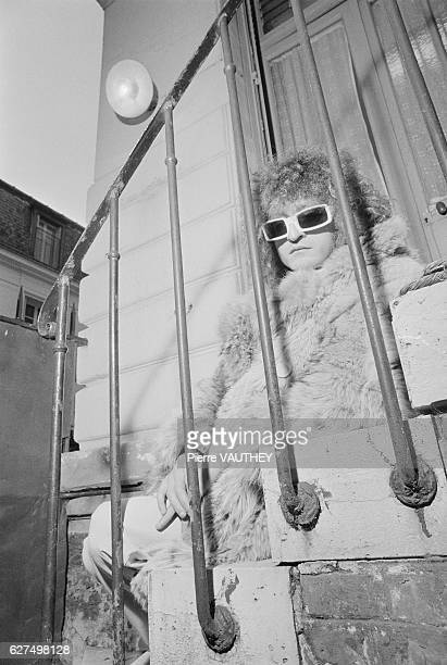 French singer Michel Polnareff sits on the steps in his Paris home