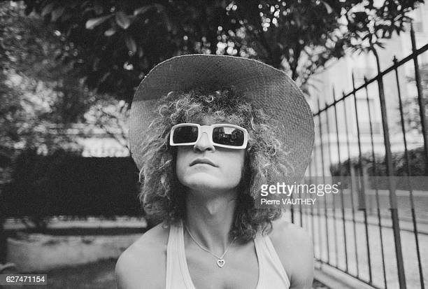 French singer Michel Polnareff wears a brimmed hat and sunglasses outside his home in Paris