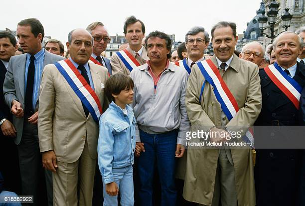 French singer Michel Sardou and his son Romain attend a demonstration in favor of private schooling with JeanPierre Bloch and Charles Pasqua in Paris...