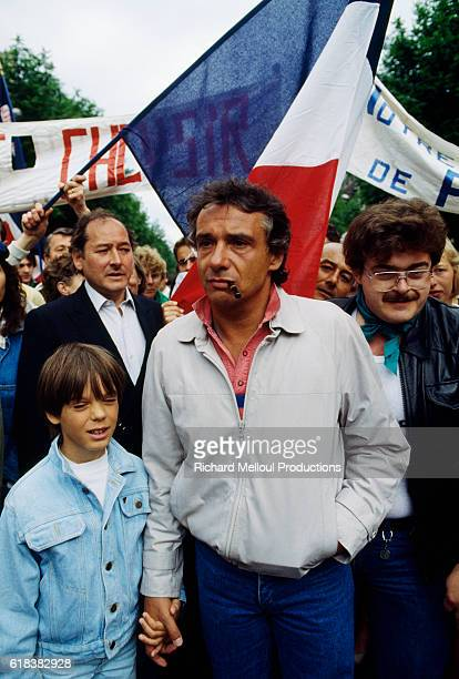 French singer Michel Sardou and his son Romain attend a demonstration in favor of private schooling in Paris, France.