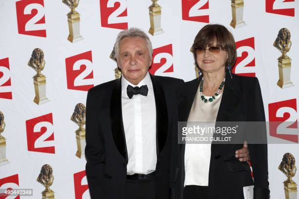 French singer Michel Sardou and his wife AnneMarie Perier pose as they arrive to attend the 26th Molieres theatre award ceremony on June 2 2014 at...
