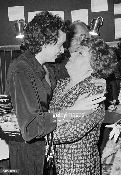 French singer Michel Sardou is congratulated by his mother Jacqueline Labbé, well-known French actress Jackie Rollin or Jacky Sardou , in front of...