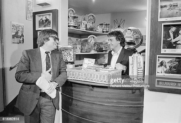 French singer Michel Sardou stands at the concession stand while acting as host for the television show La Derniere Seance