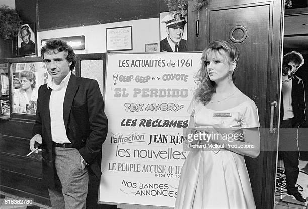 French singer Michel Sardou stands in the lobby while acting as host for the television show La Derniere Seance