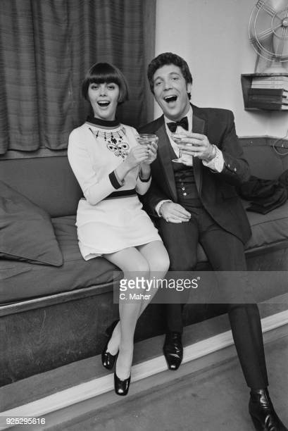 French singer Mireille Mathieu and British singer Tom Jones having a drink together at the London Palladium, UK, 26th April 1968.