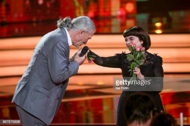 French singer Mireille Mathieu and US actor Patrick Duffy during the tv show 'Willkommen bei Carmen Nebel' on March 24, 2018 in Hof, Germany. The...