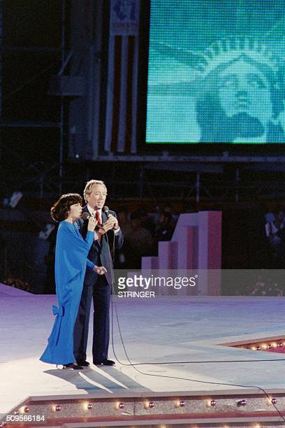 French singer Mireille Mathieu and US singer Andy Williams sing for the commemoration of the Statue of Liberty centenary on July 3 1986 during...